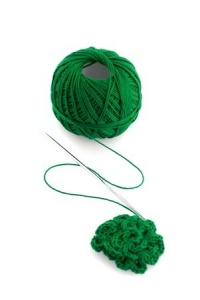 Green yarn and knitting needle